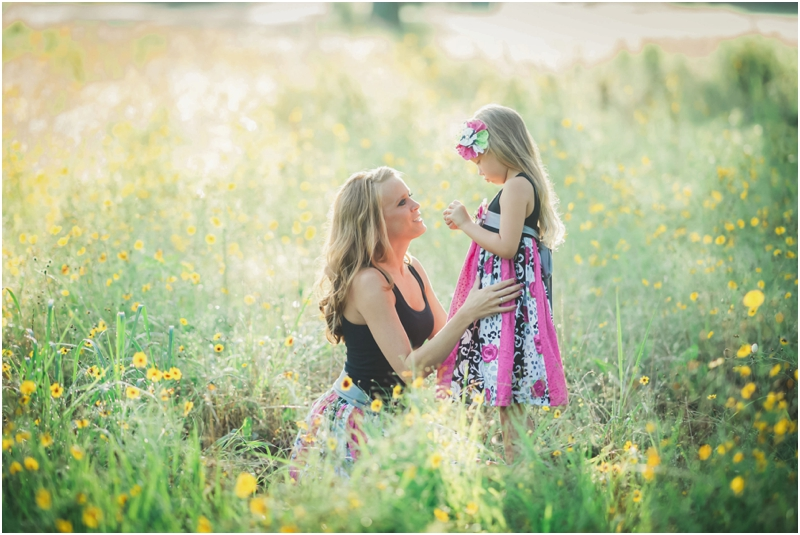 mom and daughter in yellow flower field